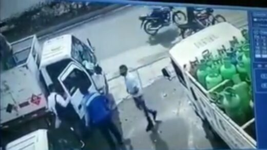 Gun wielding thug suffers some serious brain damage after a gas canister lands on his head
