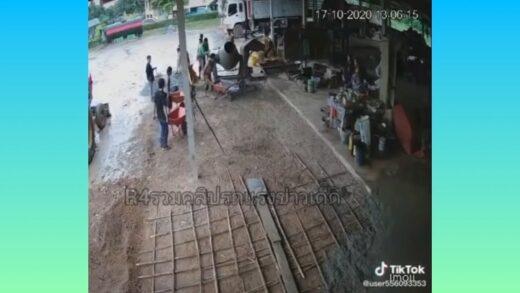 Man faceplants into wheelbarrow of cement.